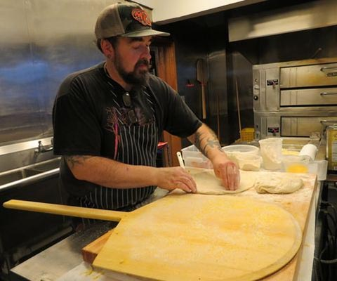 Chef Paul prepares the dough